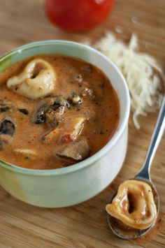 Creamy Slow-Cooker Tortellini Soup...with spaghetti sauce, cream cheese, mushrooms.  serve with some warm crusty bread