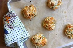 Zucchini Cheddar Drop Biscuits  Makes 15 biscuits  3/4 cup zucchini, shredded (about 1 small zucchini) 2 teaspoons salt, divided 1 cup grated cheddar 2 1/2 cups of flour 1 tablespoon baking powder 1 stick butter, cold and cubed 1 cup milk