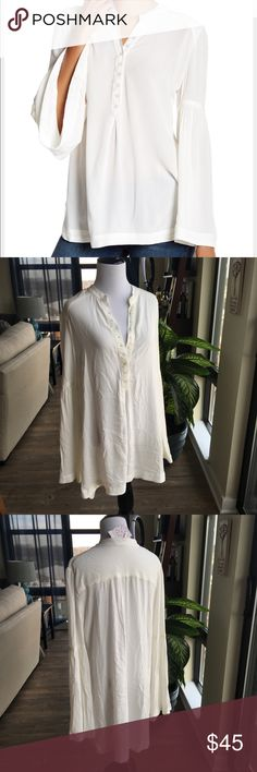 """NWT Free People 'Easy Girl' Bell Sleeve Top NWT: Free People 'Easy Girl' Bell Sleeve Top Color: Ivory Size: Medium Details & Care Cut with a free-spirited silhouette, this breezy peasant top features billowing bell sleeves and a beautifully draped high/low hem. •28 1/2"""" front length; 32"""" back length (size Medium). •Front button closure. •Band collar. •Long bell sleeves. •100% rayon. •Dry clean or machine wash cold, line dry. •By Free People; imported.  Thanks for stopping by my…"""