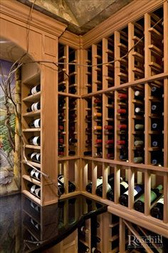 Custom designed and built #winecellar with display arch and #wine racks
