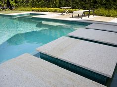 Calico Eco Outdoor Tortoise granite paving steppers used as pool steppers.