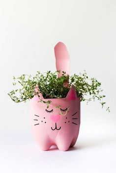 an empty soda bottle into an adorable kitty plant planter for catnip, herbs. - SALTY CANARY / Pins - Turn an empty soda bottle into an adorable kitty plant planter for catnip, herbs. Reuse Plastic Bottles, Plastic Bottle Crafts, Soda Bottle Crafts, Plastic Bottle Planter, Recycled Bottles, Diy And Crafts, Crafts For Kids, Recycle Crafts, Reuse Recycle
