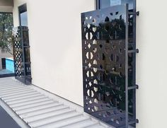 Contemporary window covers using decorative laser cut in mild steel. Installed by Installation works.
