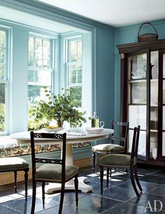 A breakfast area with natural light painted in Farrow & Ball's Ballroom Blue | archdigest.com