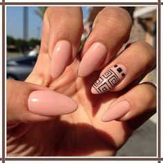 Pale pink stiletto nails. Perfect maybe minus the designs. I'm not into the feature nail look.