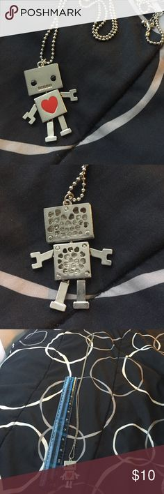 Cute robot necklace Approximately 21 inches long at full length. The arms, legs, and head move. Super cute!  Hot Topic Jewelry Necklaces