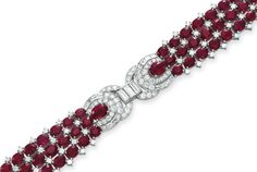 A RUBY AND DIAMOND BRACELET   Designed as a three-row oval-cut ruby band, spaced by circular and baguette-cut diamond plaques, mounted in platinum, 7 ins.  Art Deco or Art Deco style.