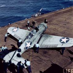 A true exotic ride! SBD Dauntless dive-bomber on a U.S aircraft carrier deck, World War II.