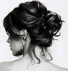 A messy bun would hide any potential for messy hair later in the evening.