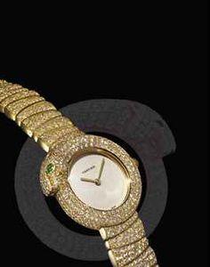 CARTIER. A FINE AND VERY RARE LADY'S 18K GOLD, EMERALD AND DIAMOND-SET BRACELET WATCH | SIGNED CARTIER, PANTHÈRE 1925 MODEL, REF. 2309, CASE NO. DM10580, CIRCA 2005