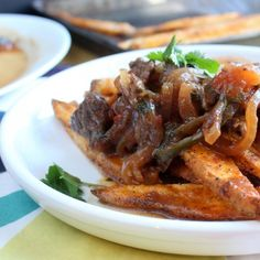 Peruvian Beef Stir fry served atop Oven Fries