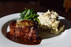Wholesome and savory: Hickory Grilled Tenderloin Filet with gorgonzola bleu cheese butter & cabernet sauce, homemade redskin mashed potatoes & sautéed spinach.