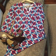 Aztec tunic/dress, small, never worn, stretchy. This is so cute. Could wear as a dress or with tights. I am 5'3 it hits me just above the knee. Comfy, stretchy material. I've never worn it. No tags, but I do have the original bag it came in if anyone wants to see ;-)) Dresses Midi