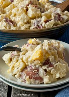Jack's Potato Salad Recipe ~ a mixture of tender-cooked new red potatoes and hard-boiled eggs that are combined with a wonderful dressing made with mayonnaise, Dijon mustard, onion, white and cider vinegar, sugar and other seasonings.  It's the perfect marriage of flavors – creaminess from the mayonnaise, a little bit of zestiness from the mustard and vinegar, and a touch of sweetness from the sugar.