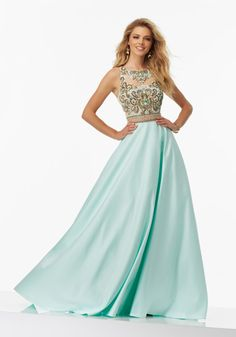 Illusion Two-Piece Sateen Prom Gown with with Beaded Net Bodice. Skirt Features Pockets. Zipper Back Closure. Colors Available: Pale Coral, Pale Aqua