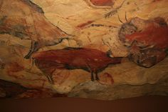 "Reproduction of CAVE OF ALTAMIRA in ""Deutsches Museum"", Munich.  The CAVE OF ALTAMIRA located near the historic town Santillana del Mar in Cantabria, SPAIN, is renowned for its numerous parietal cave paintings featuring charcoal drawings and polychrome paintings of contemporary local fauna and human hands, created between 18,500 and 14,000 years ago during the Upper Paleolithic by Paleo human settlers. The earliest paintings in the cave were executed around 35,600 years ago."