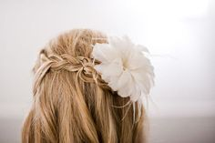 A waterfall braid, plus a faux flower? Naturally chic.