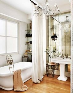 i would do very bad things to have a master bathroom like this --- antiqued mirror + clawfoot tub + chandelier!!!