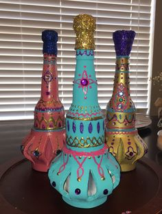 DIY Genie Bottles for #ShimmerandShine birthday party! Beer bottles, craft foam, champagne corks, spray paint and puffy paint, oh and can't forget the gems! Hot glue gun is best for this project :)