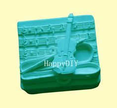 Violin With Music Notes Flexible Silicone Mold/Mould For Handmade Soap Candle Candy Jewelry Jelly Cake Fimo Resin Crafts wm117. $10.99, via Etsy.