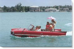 Kevin McClory takes his wife Bobo Segrist and family for a drive in an 'Amphicar' across the harbour at Nassau.