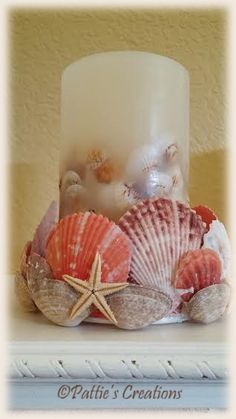 Sea shell candle holder that I made using an ordinary plastic lid, glue gun and shells. I purchased a flameless candle from Kohls that had sea shells in it. I got a great deal on the candle and wish I would have bought more.