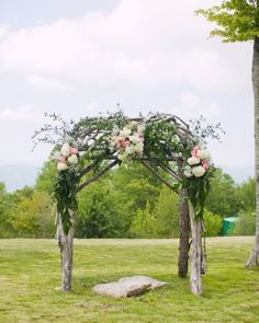 Fresh greenery and blooms turned this wooden ceremony arch into something especially springy