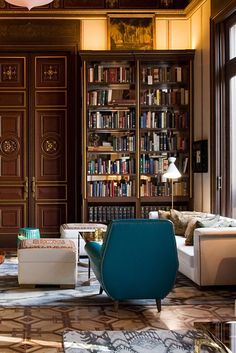 the library with its high ceilings overstuffed bookshelves and tea service is