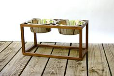 Walnut Large Dog Feeder w/ Bowls by ShopWestLakeMarket on Etsy, $75.00 Genius, less clean up :) Although it will drop to the floors...mat?
