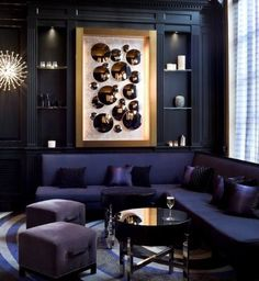 Love the dark colours and paneling for a study area