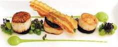 Scallops with pea puree and a fried pancetta.
