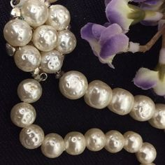 """Pearl Necklace Beautiful pearls are stunning, a large and smaller strand of pearls make a lovely piece of jewelry. Clasp measures 1 inch including seven pearls. Each Pearl has indention marks on it forming an irregular pearl. Very unique. White pearlized color. 24""""L. Jewelry Necklaces"""