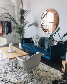 Boho style living room with large circle mirror and retro coffee table seating
