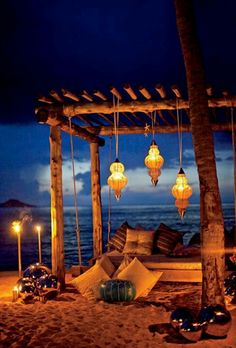 Wedding on the beach - this is it. Pillows, lanterns, and the ocean in the background