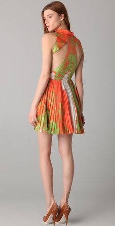 Love the cutout back and the pleats!