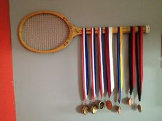 This is a nice way to display medals but not sure of this one going along with the decor. I display my medals on the curtain rods. Something of this sort would be nice to display our medals. Badminton, Tennis Decorations, Boy Room, Kids Room, Tennis Crafts, Award Display, Tennis Party, Vintage Tennis, Teenage Room
