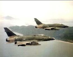 USAF North American F-100D Super Sabers on a mission during the Vietnam War.