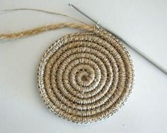 Crochet around rope or yarn to make rugs, baskets, trivets, etc. Faster than braided or sewn rag-rug method. by loracia