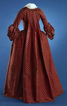 Robe à la française: ca. 1770, ribbed silk lampas with all-over pattern of small rose sprigs in supplementary weft, (lampas), scalloped edges of the bow are trimmed in chenille.
