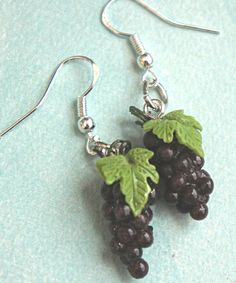These earrings feature handmade grapes charms made from polymer clay.Each measures cm long and is securely attached to a silver tone dangle hook.The entire earrings length is cm. Grape Earrings, Fancy Earrings, Diy Earrings, Inexpensive Jewelry, Simple Jewelry, Sterling Silver Bracelets, Silver Jewelry, Silver Earrings, Jewelry Rings
