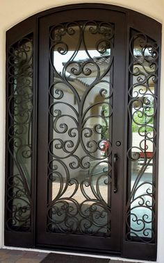 What do you usually have in mind when you think of wrought iron doors? Most people will probably associate them with fences or garden doors. Others ma. Wrought Iron Front Door, Gate Design, Wrought Iron Decor, Metal Doors Design, Wrought Iron Gates, Metal Door, Front Door, Exterior Doors, Steel Doors