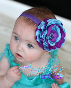 Stunning Spring Purple and Turquoise Ruffled Flower on a stretchy Headband.. $10.25