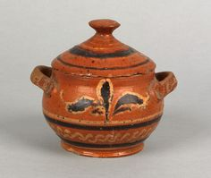 "North Carolina Moravian glazed redware covered sugar, 18th c., with applied handles and yellow and black manganese slip leaf and line decoration, 5 1/4"" h. For examples and reference see Bivins The Moravian Potters in North Carolina. Provenance: Titus Geesey 1960."