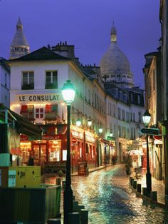 Rainy Street and Dome of the Sacre Coeur, Montmartre, Paris, France by Gavin Hellier