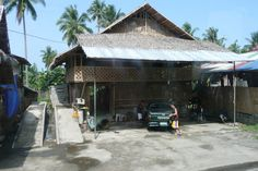 Local shop by the road - combination metal and palm leaf roof, screening elements, bamboo and concrete structure