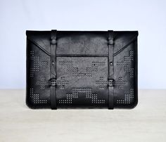 Macbook sleeve with pixel pattern on the outside. I love the look of these.