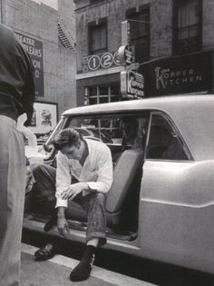 Elvis is photographed sitting in his Continental Mark II and putting his shoes on after a long ride from Jacksonville, FL to New Orleans on August 12, 1956.