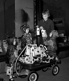 Costumed kids with a wagon full of candy (or possibly Unicef) boxes, 1954. #vintage #1950s #Halloween #nostalgia