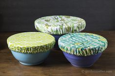 Three fabric bowl covers in pretty prints.