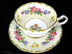 """Circa: 1937  Size: Saucer 5.5"""" - 14cm.  Manufacturer: Paragon China    A good Paragon bone china cup & saucer with center gilded royal cipher of GRI (for Georgius Rex Imperator; George, King and Emperor)surrounded by flowers of the realm."""